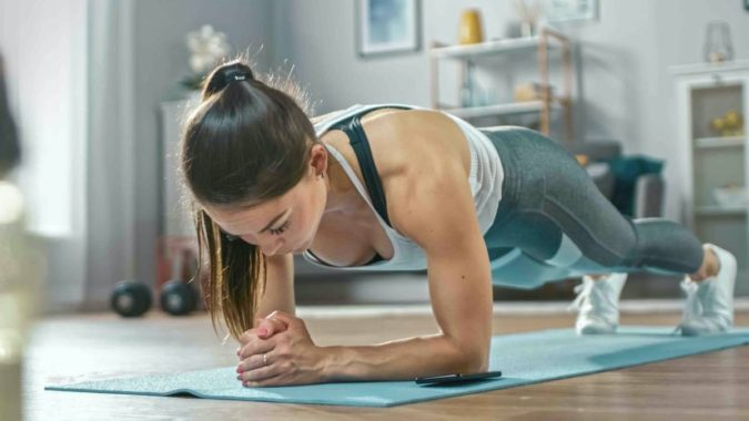 woman-exercising-with-mobile-fittness-app-675x380 7 Benefits of GetFit Fitness Mobile App for Your Health