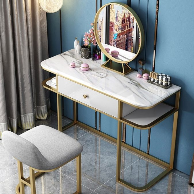 A-table-set-with-round-regular-mirror.-675x675 Hottest 50+ Stylish Makeup Vanity Ideas