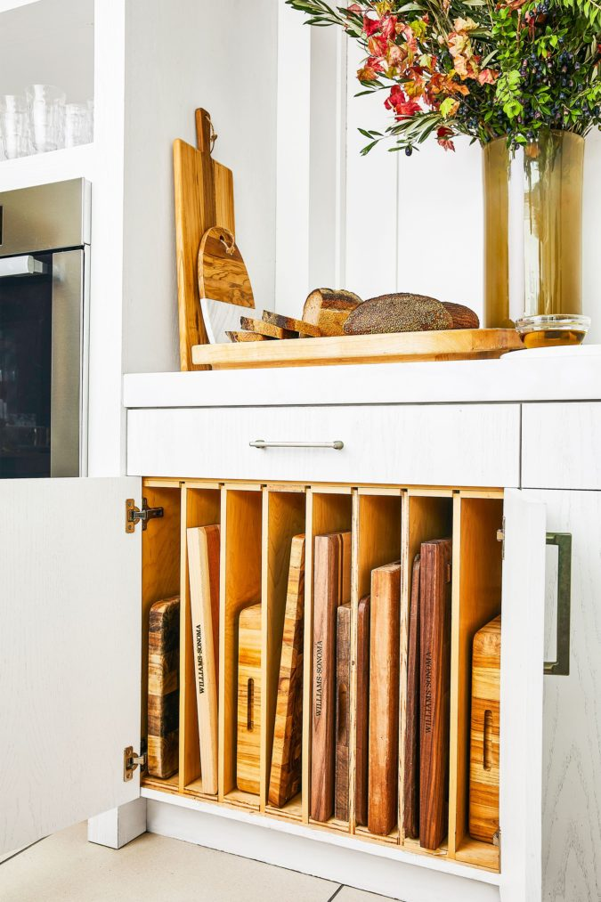 Creating-cutting-board-slots-675x1013 100+ Smartest Storage Ideas for Small Kitchens in 2021