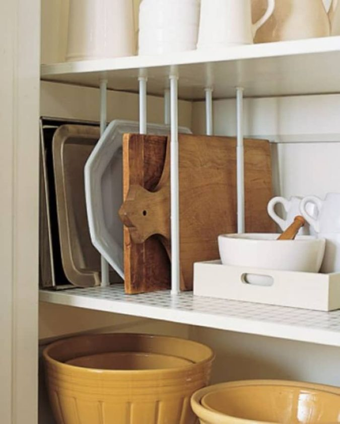 Creating-cutting-board-slots..-675x842 100+ Smartest Storage Ideas for Small Kitchens in 2021