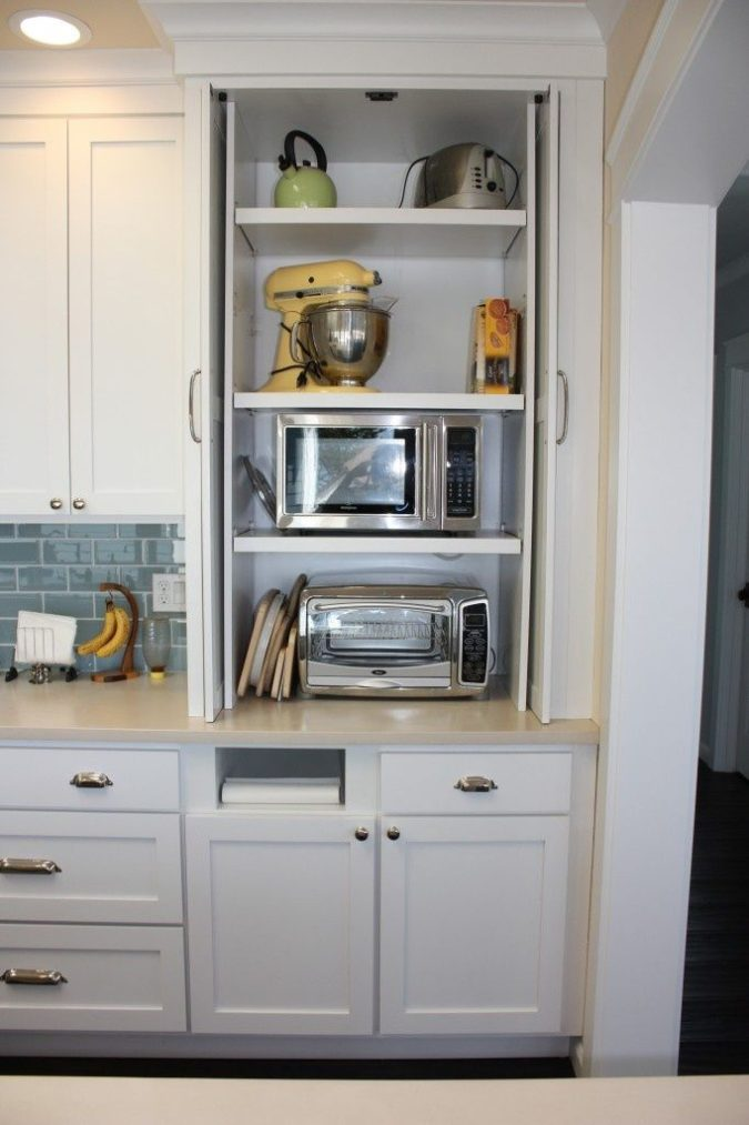 Hiding-appliances-1-675x1013 100+ Smartest Storage Ideas for Small Kitchens in 2021