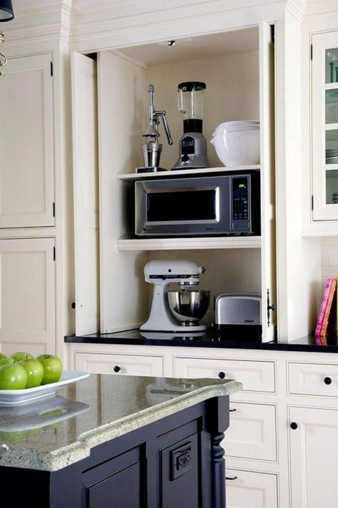 Hiding-appliances.-675x1013 100+ Smartest Storage Ideas for Small Kitchens in 2021