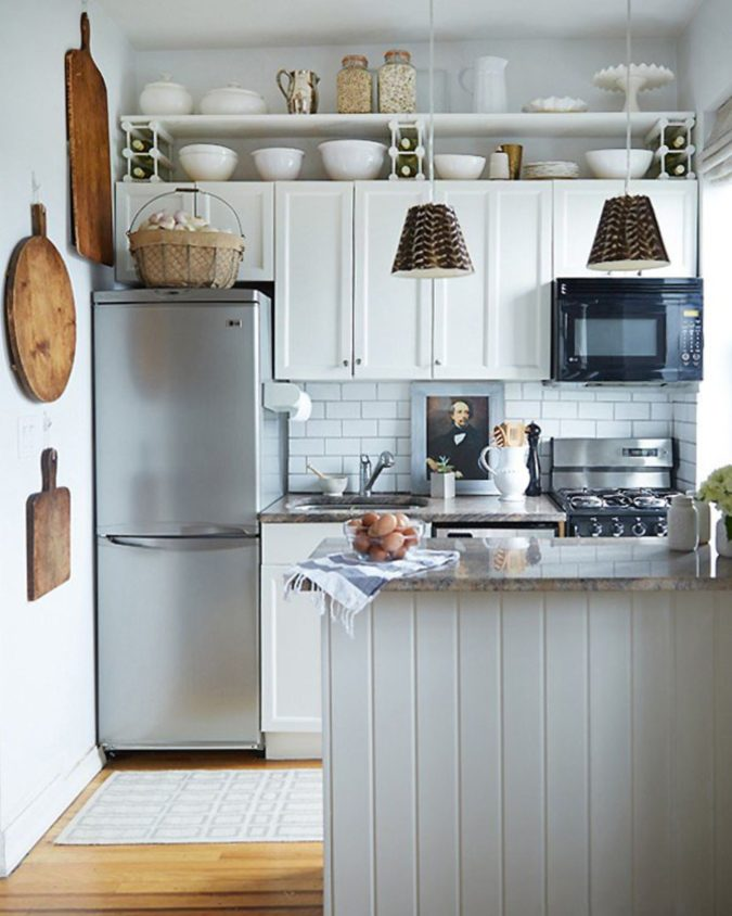 Maximizing-cabinet-top-3-675x844 100+ Smartest Storage Ideas for Small Kitchens in 2021