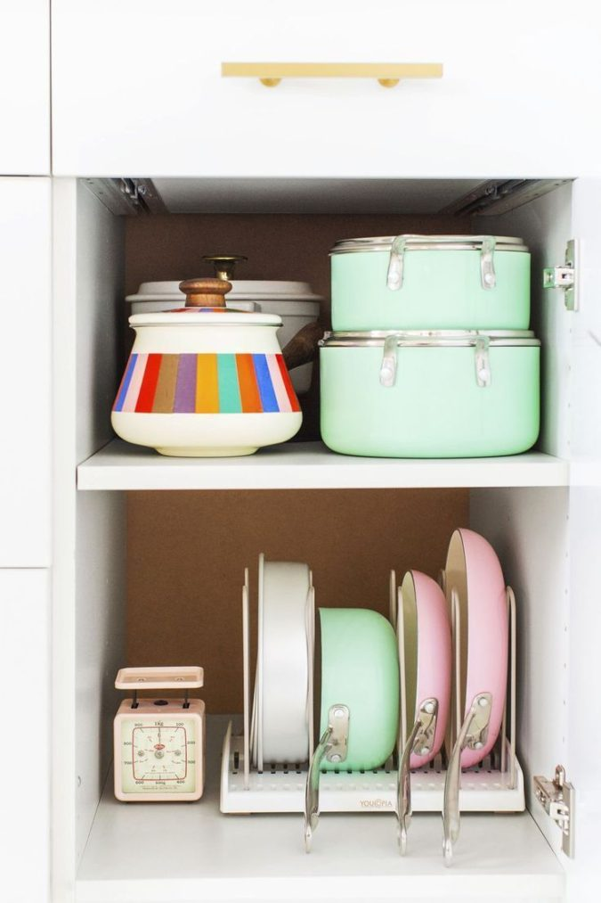 Storing-pans-sideways-675x1013 100+ Smartest Storage Ideas for Small Kitchens in 2021