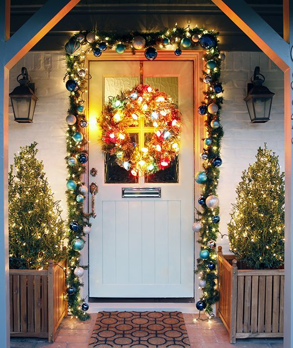 Christmas-door-light-decoration Let Your Outdoor Area Twinkle by This Year Christmas Lights Decorations