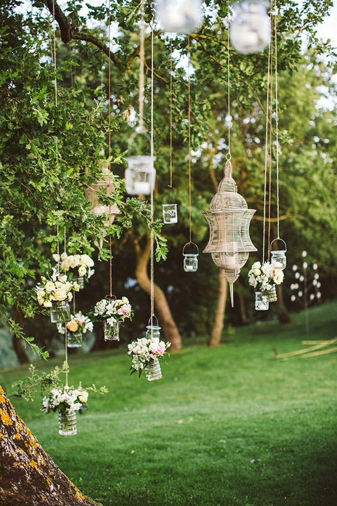 hanging-decorations-in-tree 100+ Surprising Garden Design Ideas You Should Not Miss in 2021