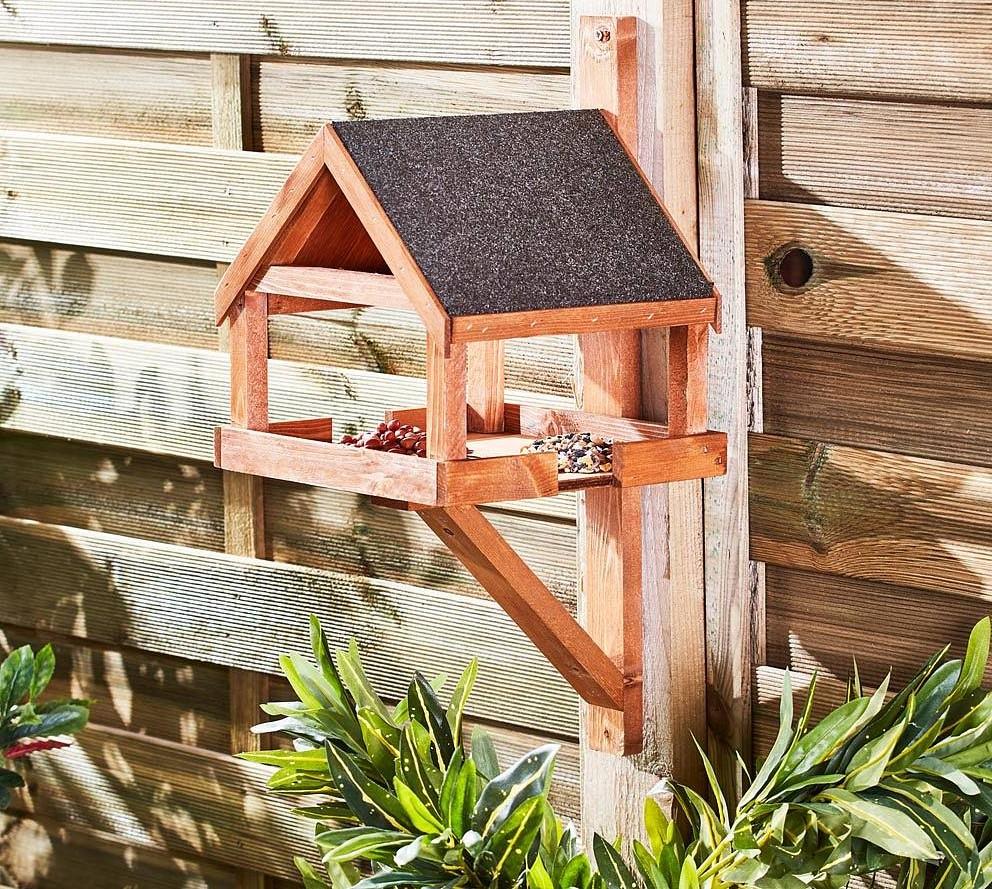 hang-bird-feeders-on-fences.. 100+ Surprising Garden Design Ideas You Should Not Miss in 2021
