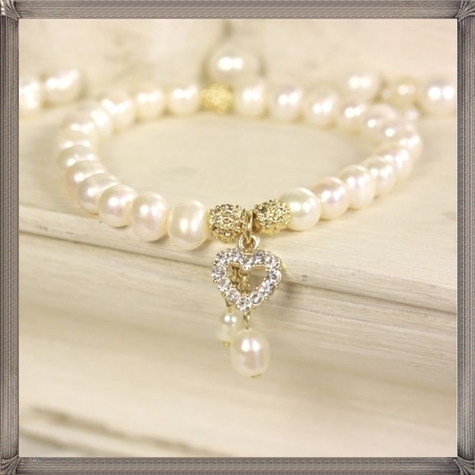 Bridal-Crystal-Heart-Pearl-Bracelet-in-Silver-or-Gold 28+ Most Amazing Pearl Bracelets For Brides