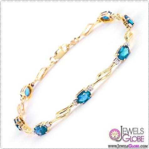 QP-14K-Gold-Tennis-Bracelet-Blue-Topaz-and-Diamond Blue Topaz Tennis Bracelet