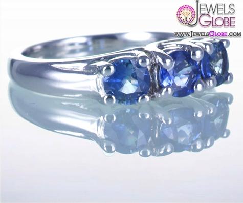 THREE-STONE-MEDIUM-LIGHT-BLUE-SAPPHIRE-Engagement-RING Top 21 Blue Sapphire Engagement Rings Designs